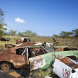 Rusty car in junkyard. — Stock Photo