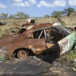 Rusty car in junkyard. - Stockfoto