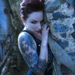 Stock Photo: Portrait of tattooed woman.