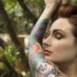 Attractive tattooed woman. - Stock Photo