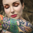 Stock Photo: Nude tattooed woman.