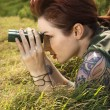 Woman spying. - Stock Photo