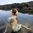 Tattooed woman in bikini. — Stock Photo