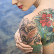 Nude tattooed woman. - Stock Photo