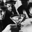 Stock Photo: Retro men drinking martinis.