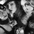 Foto de Stock  : Retro women with martinis.