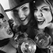 Three retro women drinking. — Zdjęcie stockowe