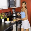 Attractive Young Woman in Kitchen Cooking Breakfast - Stok fotoğraf