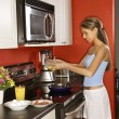 Attractive Young Woman in Kitchen Cooking Breakfast — Stock Photo