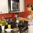 Attractive Young Woman in Kitchen Cooking Breakfast — Foto Stock