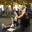 Woman with personal trainer. — Stock Photo