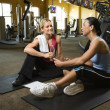 Stock Photo: Woman with trainer at gym.