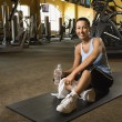 Woman at fitness gym. - Stock Photo