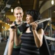 Stock Photo: Woman at gym with trainer.