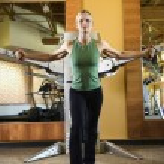 Woman using exercise equipment. — Stock Photo