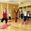 Women in yoga class. - Stock Photo