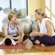 Stock Photo: Women Sitting and Socializing at Gym