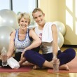 Women Sitting and Smiling at Gym — Stock Photo #9365922