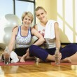 Women Sitting and Smiling at Gym — Stock Photo