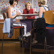 Stock Photo: Women at fitness cafe.