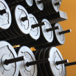 Stock Photo: Stacked barbells with weights.