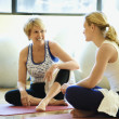 Women Sitting and Socializing at Gym - Stock Photo