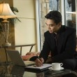 Stock Photo: Young Businessmusing Laptop