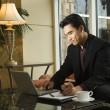Young Businessman using Laptop — Stockfoto