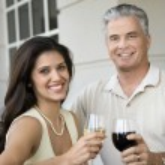 Smiling couple drinking wine. — Stock Photo