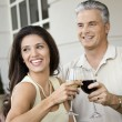 Stock Photo: Couple toasting with wine.