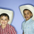 Boys wearing cowboy hats. - Stock Photo