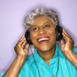 Woman listening to headphones. — Stock Photo