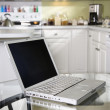 Laptop computer in kitchen. — Stock Photo
