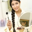Stock Photo: Young Woman Applying Makeup