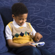图库照片: Boy playing video game.