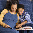 Woman Reading Book to Son — Stockfoto