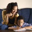 Woman Helping Son with Homework — Stockfoto