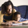Royalty-Free Stock Photo: Woman Helping Son with Homework