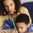 Mother helping son do homework. — Stock Photo