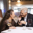 Stock Photo: Mature mproposing to woman.