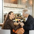 Couple sitting at bar. — Foto Stock