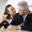 Couple drinking at bar. — Stock Photo