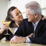 Couple drinking at bar. — Stock Photo