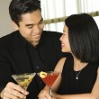 Stock Photo: Attractive Young Couple With Cocktails Smiling