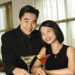 Attractive Young Couple With Cocktails Smiling — Stock fotografie