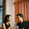 Attractive Young Couple Smiling at Each Other — Stock Photo