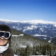 Woman skier in mountains. — Stock Photo #9367926