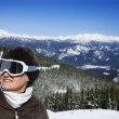 Woman skier in mountains. — Stock Photo #9367929