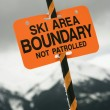 Ski area trail boundary sign. - Stock Photo