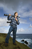 Man carrying camera equipment. — Stock Photo